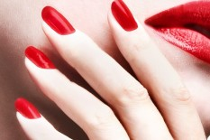 Woman with red nail varnish | Pic: Getty Images
