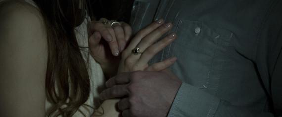 COUPLE HOLDING HANDS DARK