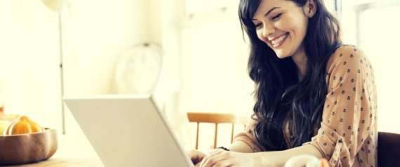 WOMAN LAPTOP SMILING