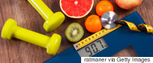 FRUIT ON A SCALE WITH A MEASURING TAPE