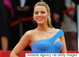 Blake Lively Happily Shows Off Baby Bump In Versace At Cannes
