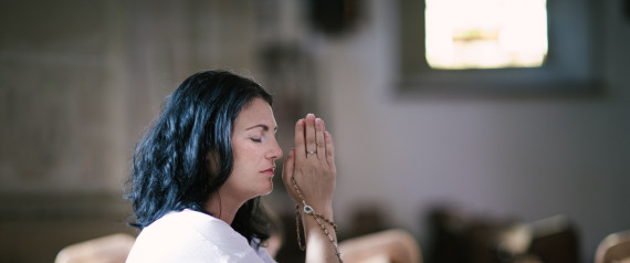 WOMEN PRAYING IN CHURCH