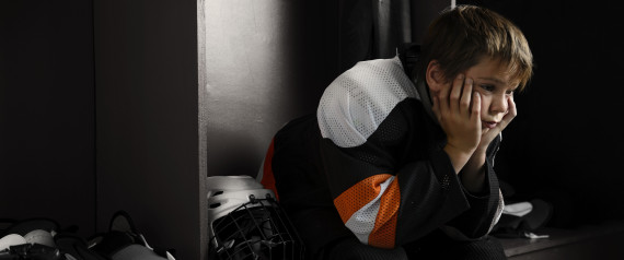 CHILD HOCKEY SAD