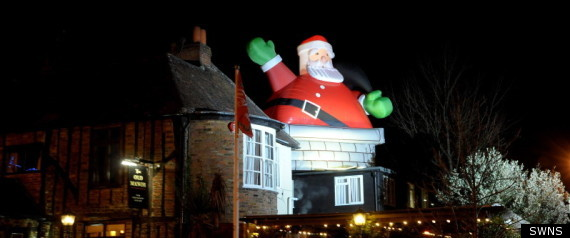 Huge inflatable santa claus rips apart pub roof pictures