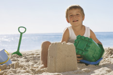Boy making sandcastle | Pic: Getty Images