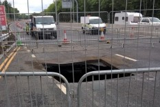 Sinkhole opens on A1 | Pic: AP
