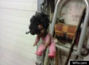 Black Baby Doll Found Hanging From Noose an African-American baby doll, dressed in bright pink, hung by a noose made of metal chains…