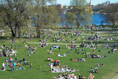 People in park on sunny day | Pic: Reuters