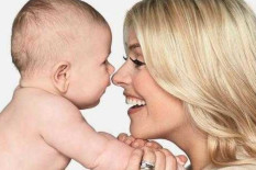 Holly Willoughby holding baby | Pic: PA