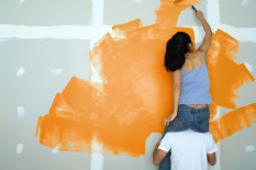 Couple painting a room | Pic: Getty