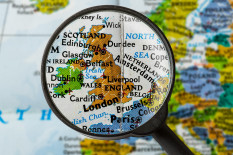 Map of UK under magnifying glass | Pic: Getty