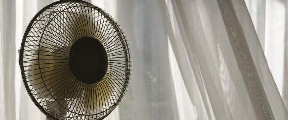ELECTRIC FAN BESIDE APARTMENT WINDOW WITH WHITE