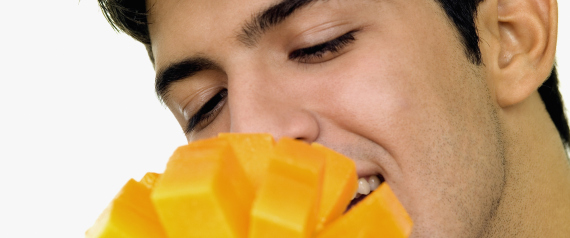 MAN EATING MANGO