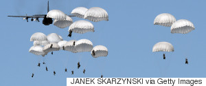 POLISH TROOPS LAND WITH PARACHUTES
