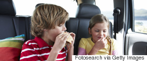 CHILD IN CAR EATING
