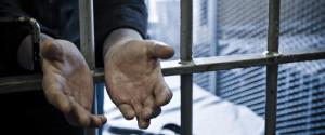 PRISON CELL DOOR HANDS
