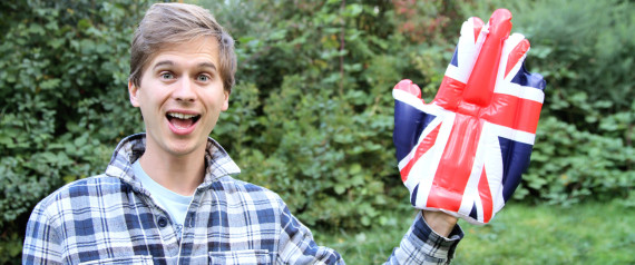 YOUNG WAVING ENGLISH FLAG