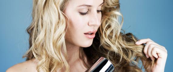 WOMAN BLOWDRYING HAIR