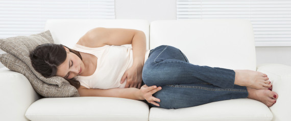 WOMAN PAIN SOFA