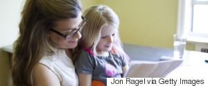 CHILD READING PARENT