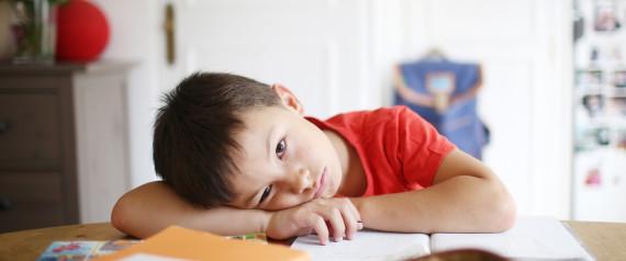 TIRED CHILD HOMEWORK TABLE