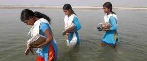 GIRLS CROSSING RIVER