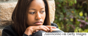 DEPRESSED YOUNG BLACK WOMAN