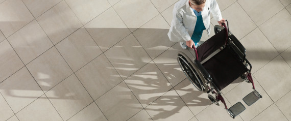 WOMAN WHEELCHAIR HOSPITAL