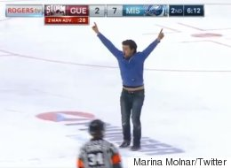Crazed Hockey Fan Runs Around On Ice During Game