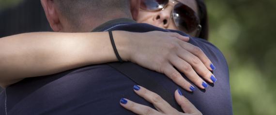 WOMAN HUGGING MAN LOVE