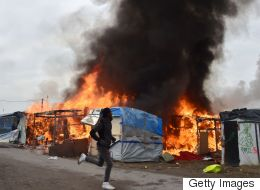 Migrants Set Fire To Calais Camp During Evacuations