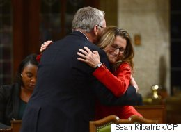 Trade Minister Hugs Conservative Predecessor To Mark CETA Signing