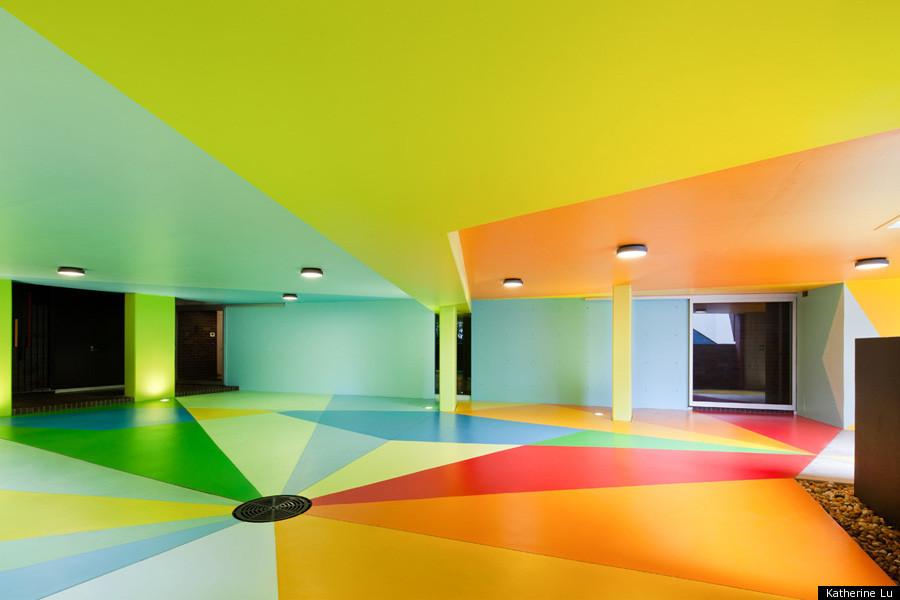 International art duo creates colorful parking lot huffpost for Beautiful garage interiors