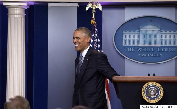 obama smile podium