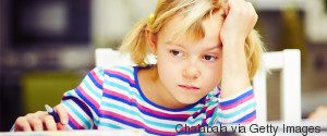 LITTLE CHILD IN SCHOOL SERIOUS TIRED