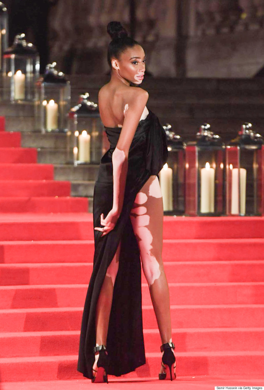 Winnie harlow stuns in baja east slit gown at the 2016 for British mode