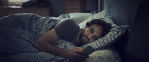 Smartphone Man Bed