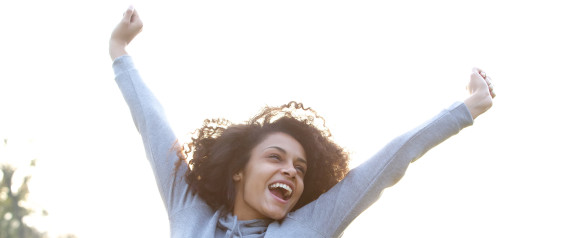 SMILING EXCITED BLACK WOMAN