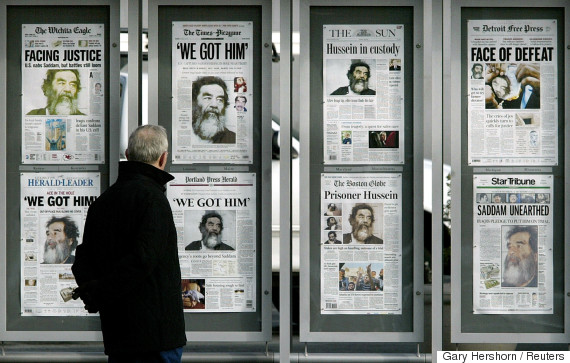 saddam hussein newspapers