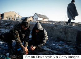 Refugees Risk Freezing To Death In Serbian Warehouses