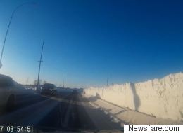 ► Giant Walls Of Snow Are Stacked Along Winnipeg's Roads