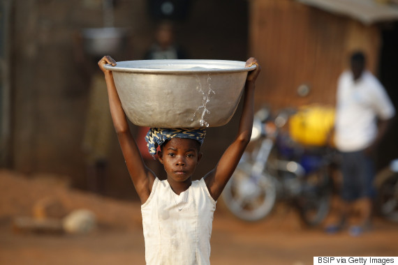 girl balancing water head