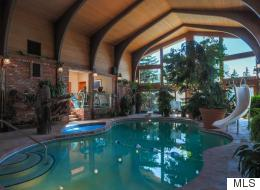 Calgary Billionaire's Home For Sale Includes POOL IN THE LIVING ROOM