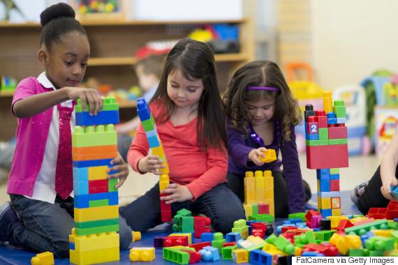 diverse kids playing toys