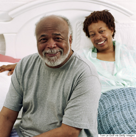 older couple happy bed