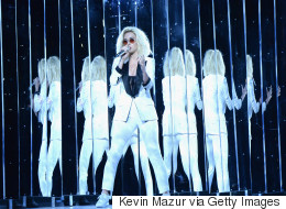 Katy Perry Rocks White Pantsuit, 'Persist' Armband At The Grammys