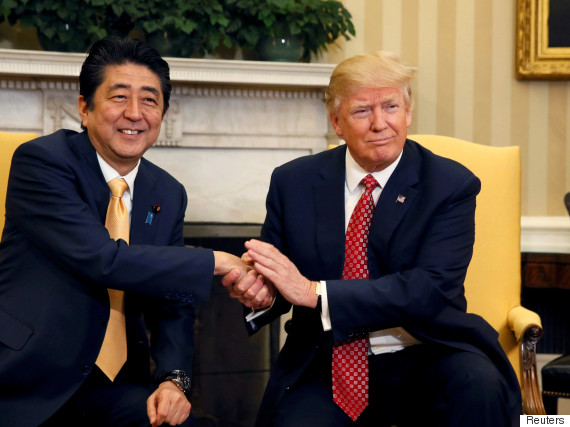 trump shakes hands japan