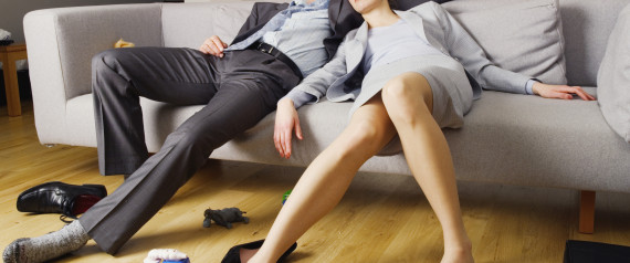 MAN WOMAN EXHAUSTED COUCH