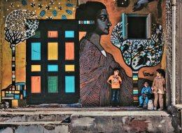 الكاميرا اكتشفتهم صدفة.. رسامون يحولون جدران قرية مصرية إلى لوحات فنية رائعة