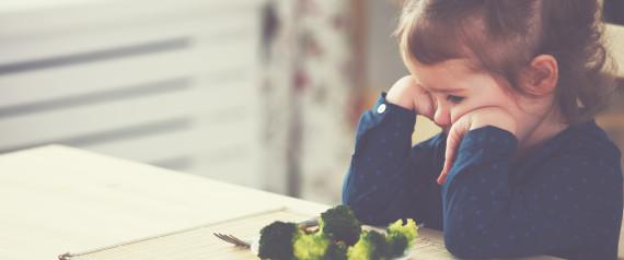 CHILD EATING SAD
